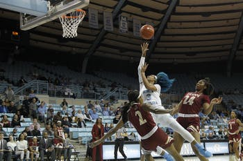 UNC senior guard Madinah Muhammad (3) shoots over Elon sophomore guard Kayla Liles (2). The Tar Heels beat the Elon Phoenix 76-46 in Chapel Hill, N.C. on Nov. 22, 2019.