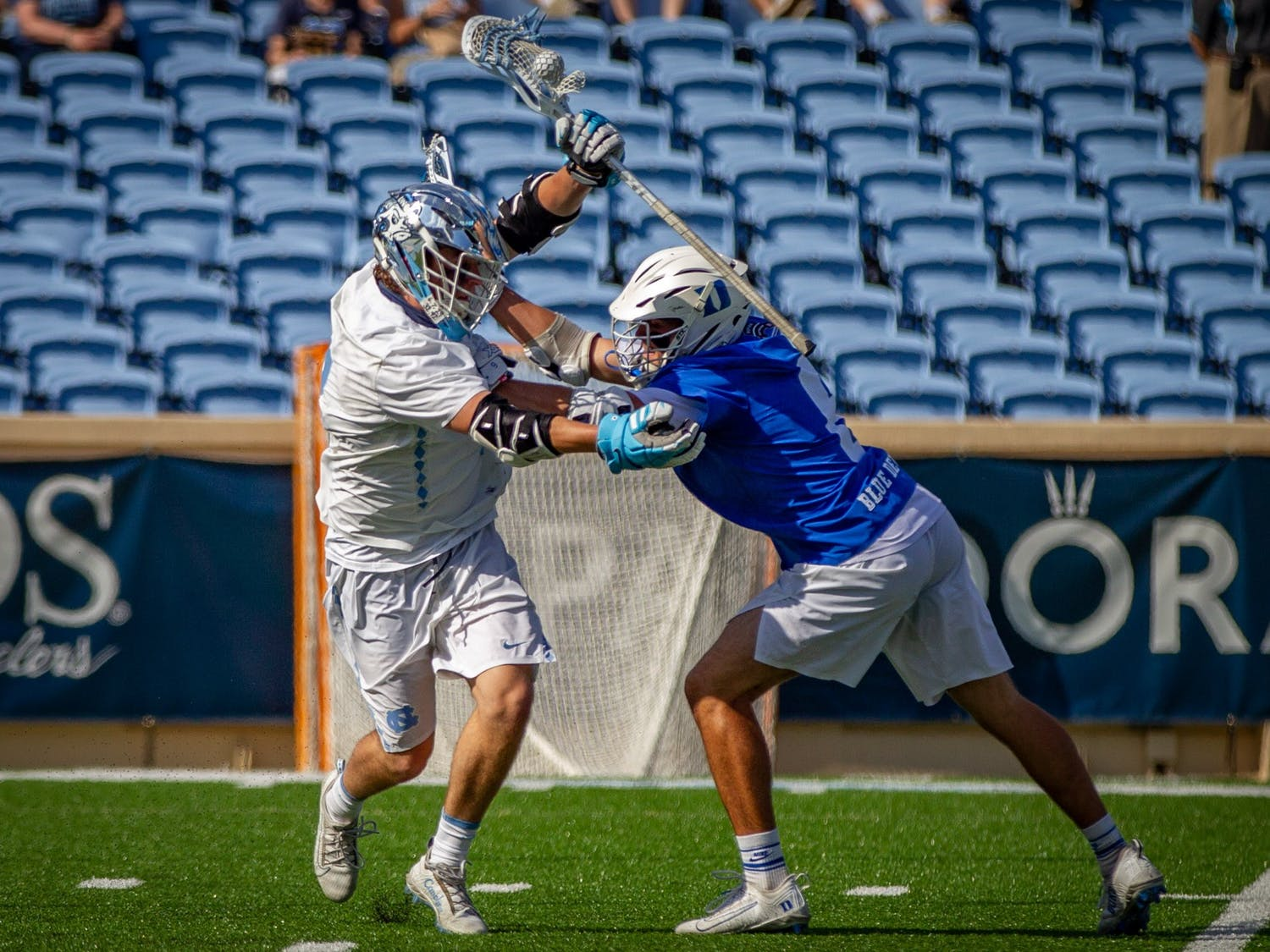UNC senior midfielder William Perry (3) attempts to keep possession from Duke sophomore midfielder Jake Caputo (6) during the Tar Heels' 15-12 victory against Duke on Sunday, May 2. With the victory, UNC and Duke share the 2021 ACC regular season title.