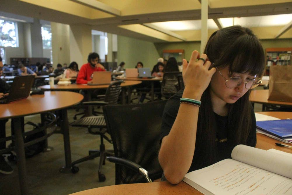 First-year Jade Henderson studies for her upcoming Intermediate Written Chinese midterm in Davis Library on Tuesday Feb. 25, 2020.