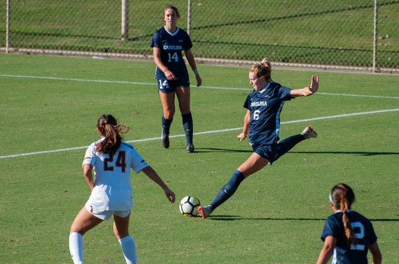 Forward (6) Taylor Otto clears the ball during Thursday's game against Boston College at WakeMed Soccer Park.