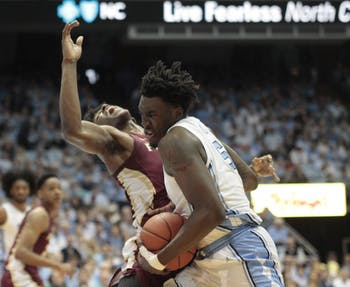 First-year guard Nassir Little (5) drives the ball during UNC's 77-59 win over FSU at the Smith Center on Saturday, Feb. 23, 2019.