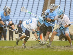 Midfielder Zachary Tucci (35) fights for the ball following a face-off during the game against Johns Hopkins on Saturday, Feb. 24, 2019. Johns Hopkins defeated the Tar Heels 11-10.