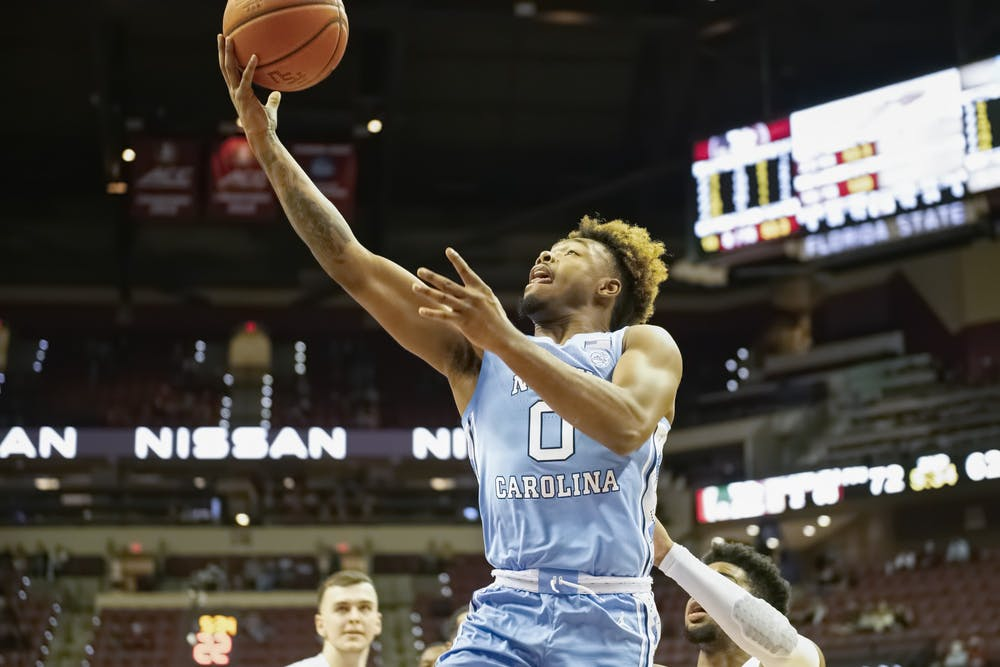 <p>UNC redshirt first year Anthony Harris (0) attempts a layup during a game against Florida State on Saturday, Jan. 16, 2021. UNC fell to FSU 72-85. Photo courtesy of Miguel A. Olivella, Jr.</p>