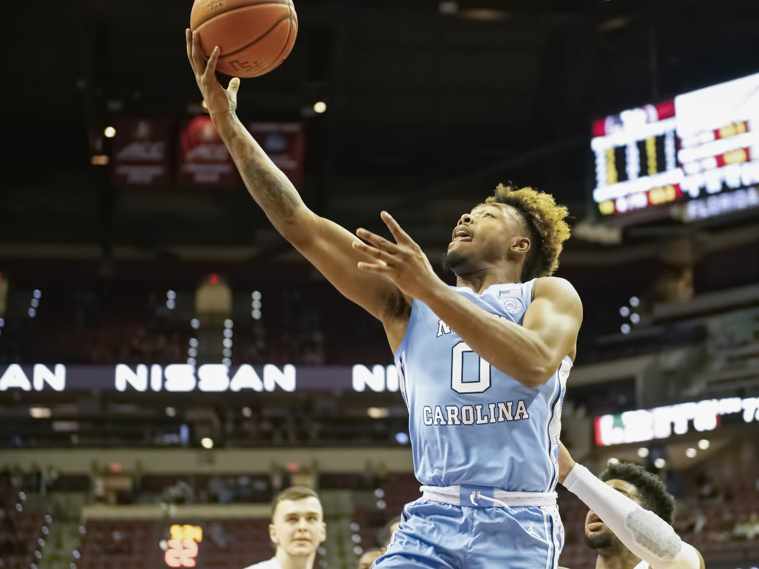 UNC redshirt first year Anthony Harris (0) attempts a layup during a game against Florida State on Saturday, Jan. 16, 2021. UNC fell to FSU 72-85. Photo courtesy of Miguel A. Olivella, Jr.