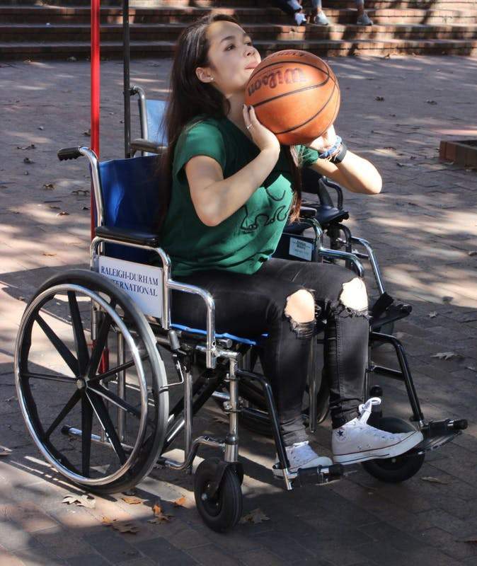 UNC student Elizabeth Chen attempts to score during wheelchair basketball.