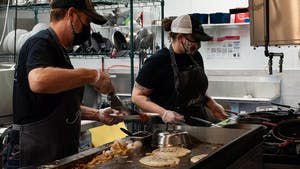 """Chefs prepare food at the new Grata Cafe in Carrboro recently opened on Sunday, August 8th. Owner Jay Radford says that """"the staff are amazing and the food... the food is just great."""""""