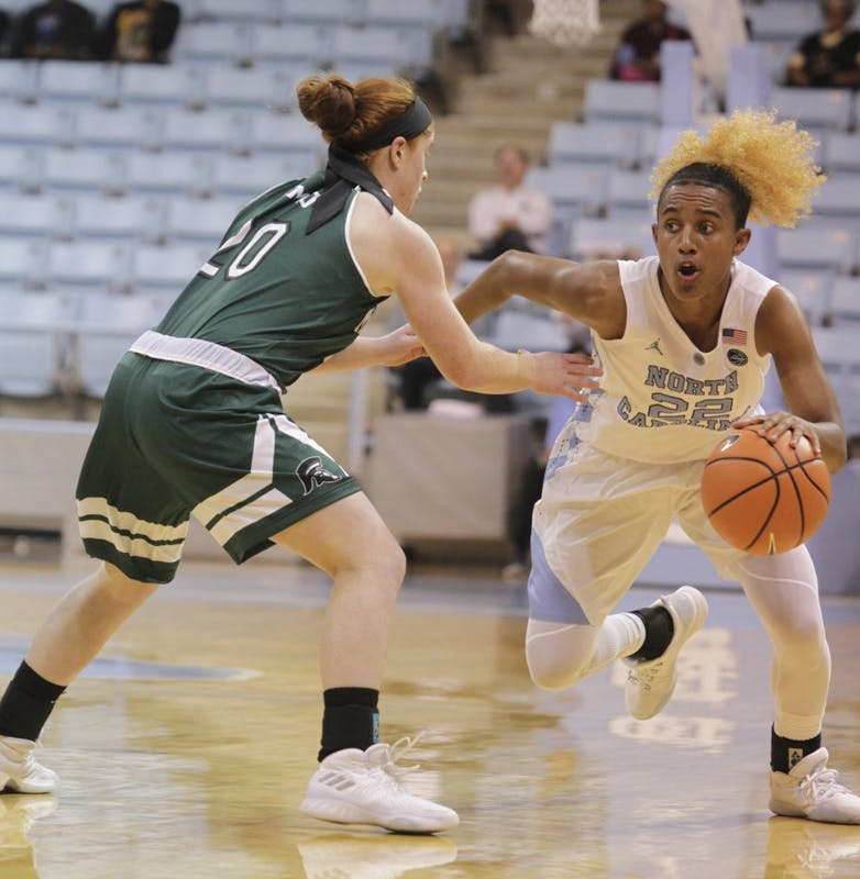 Guard Paris Kea (22) gets past a Mount Olive defender in an exhibition game on Monday in Carmichael Arena.