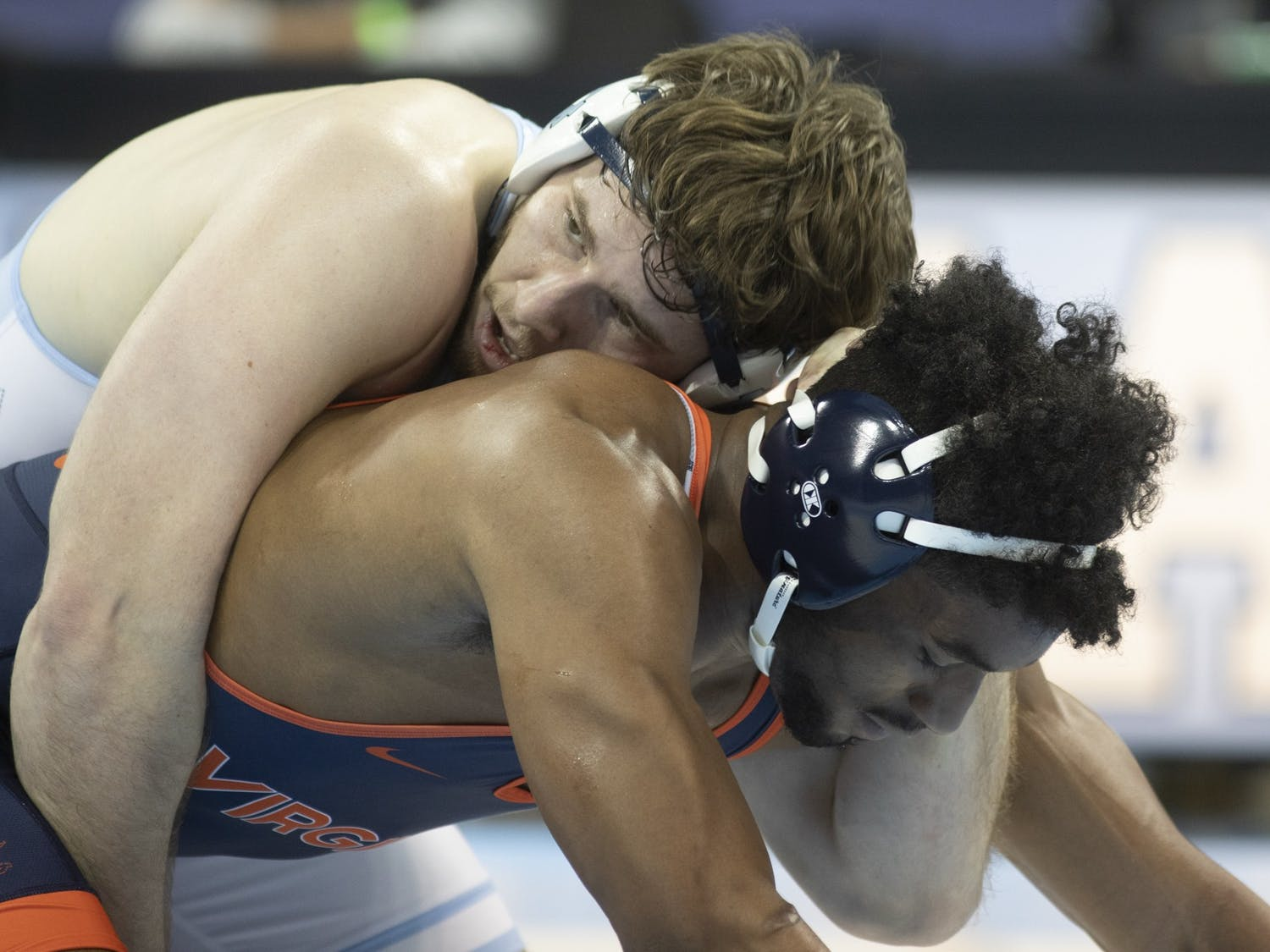 Andrew Gunning wrestles against UVA's Ethan Weatherspoon in the 285 lbs weight division in Carmichael Arena on Feb. 13, 2021. Gunning won his match and UNC won overall, 25-9.