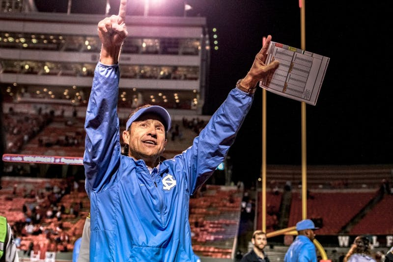 Coach Larry Fedora thanks fans at the end of both the Tar Heels' historic regular season and decisive 45-34 victory over N.C. State on Sunday.