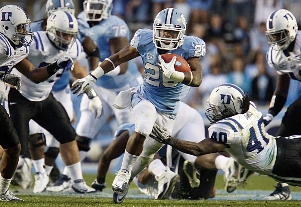 Carolina tailback Giovani Bernard breaks away from the Duke defense to score a touchdown in the second quarter. The Tar Heels defeated the Blue Devils 37-21 at Kenan Stadium on Saturday.