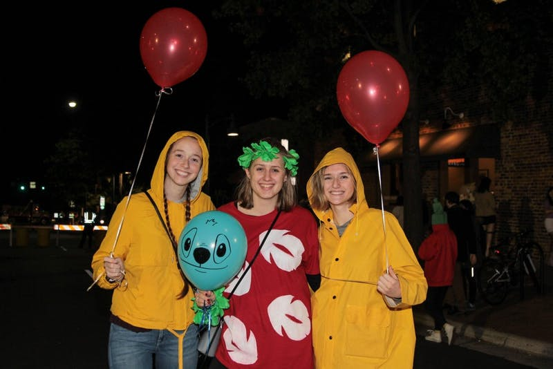 Justine Bessette, Megan Byrns and Laura Katthoefer enjoy the night out on Franklin Street.