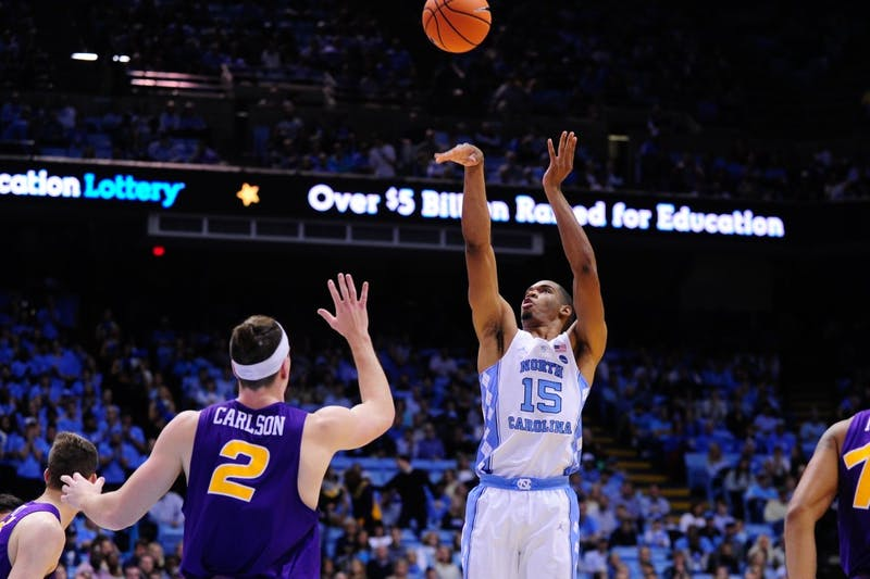 First year Garrison Brooks (15) shoots over a UNI defender Friday night.