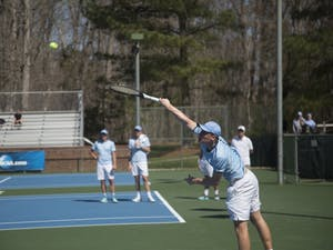 Sophomore Mac Kiger serves against Miami on Sunday, March 24 2019 at Cone-Kenfield Tennis Center. UNC defeated Miami 4-1.
