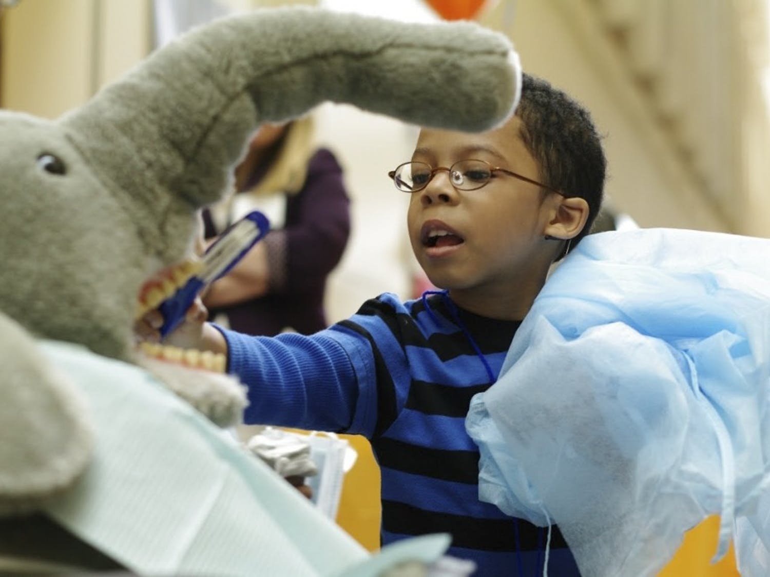 The School of Dentistry provided free dental care to around 100 children on Feb. 6, 2015. Kaleb Blue, then a 3-year-old student at Durham Head Start, practiced brushing teeth on a stuffed animal during the event.