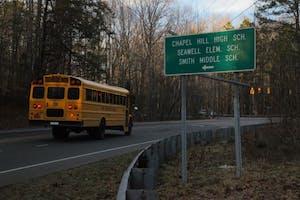 A Chapel Hill-Carrboro City Schools bus drives toward Chapel Hill High School.