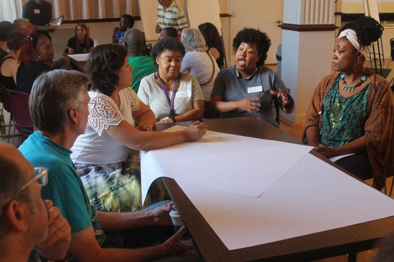 Parents and teachers discuss racial inequalities in the Chapel Hill-Carrboro City School system at the Carrboro Century Center in September.