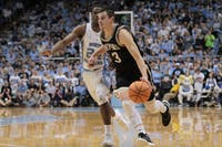 Wofford guard Fletcher Magee (3) drives past North Carolina guard Kenny Williams (24) on Dec. 20 in the Smith Center.