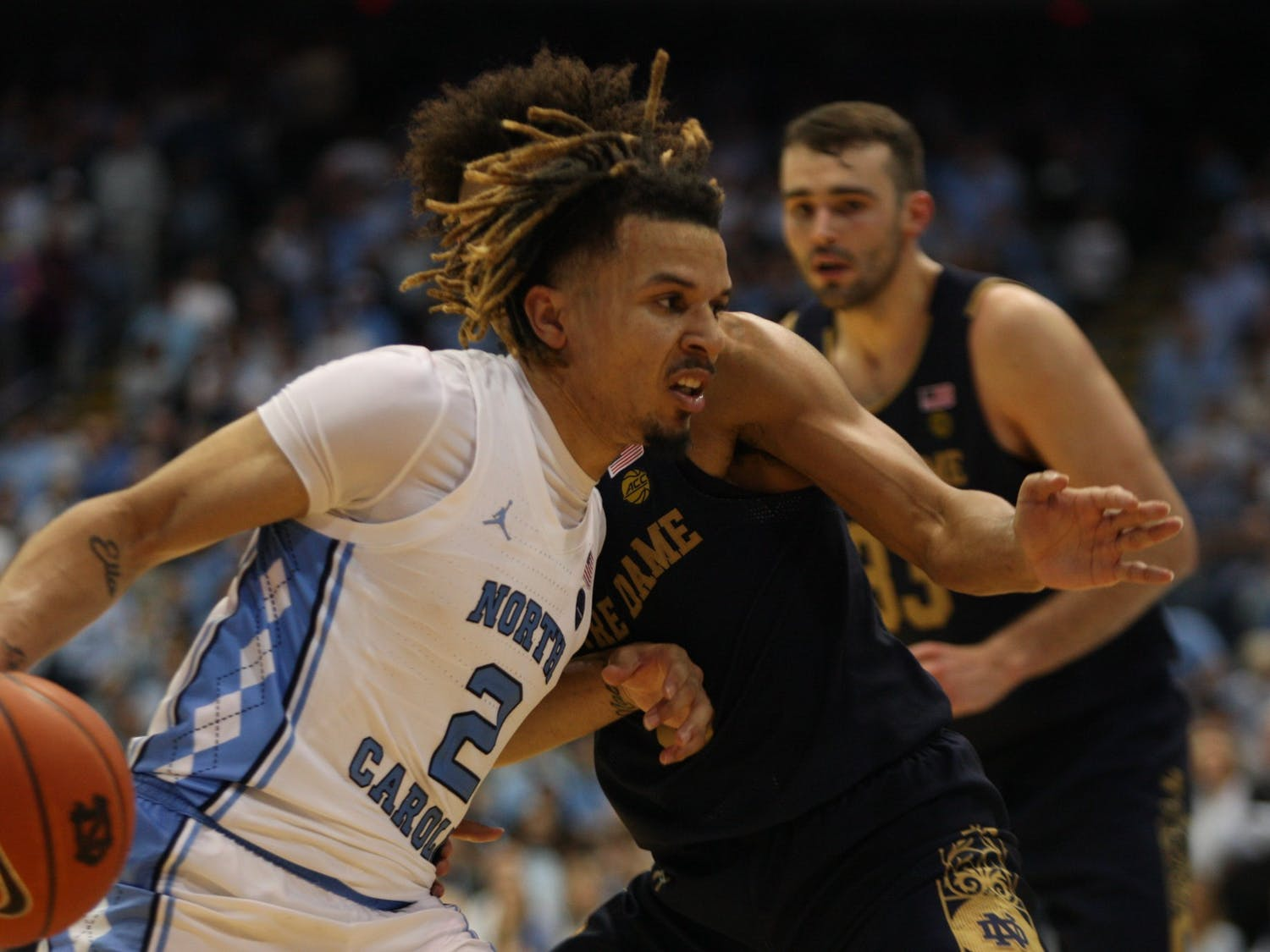 UNC guard Cole Anthony (2) drives past Notre Dame's Prentiss Hubb (3) on Nov. 6, 2019 in the Dean E. Smith Center. Anthony finished the game with 34 points and 11 rebounds. The Tar Heels beat the Fighting Irish 76-65.
