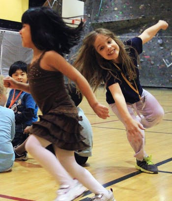 Ana Elisa Lackey age 6 plays duck duck goose with her sister Sophie Lackey age 9 between songs at the Chapel Hill Community Center's child zumba class.