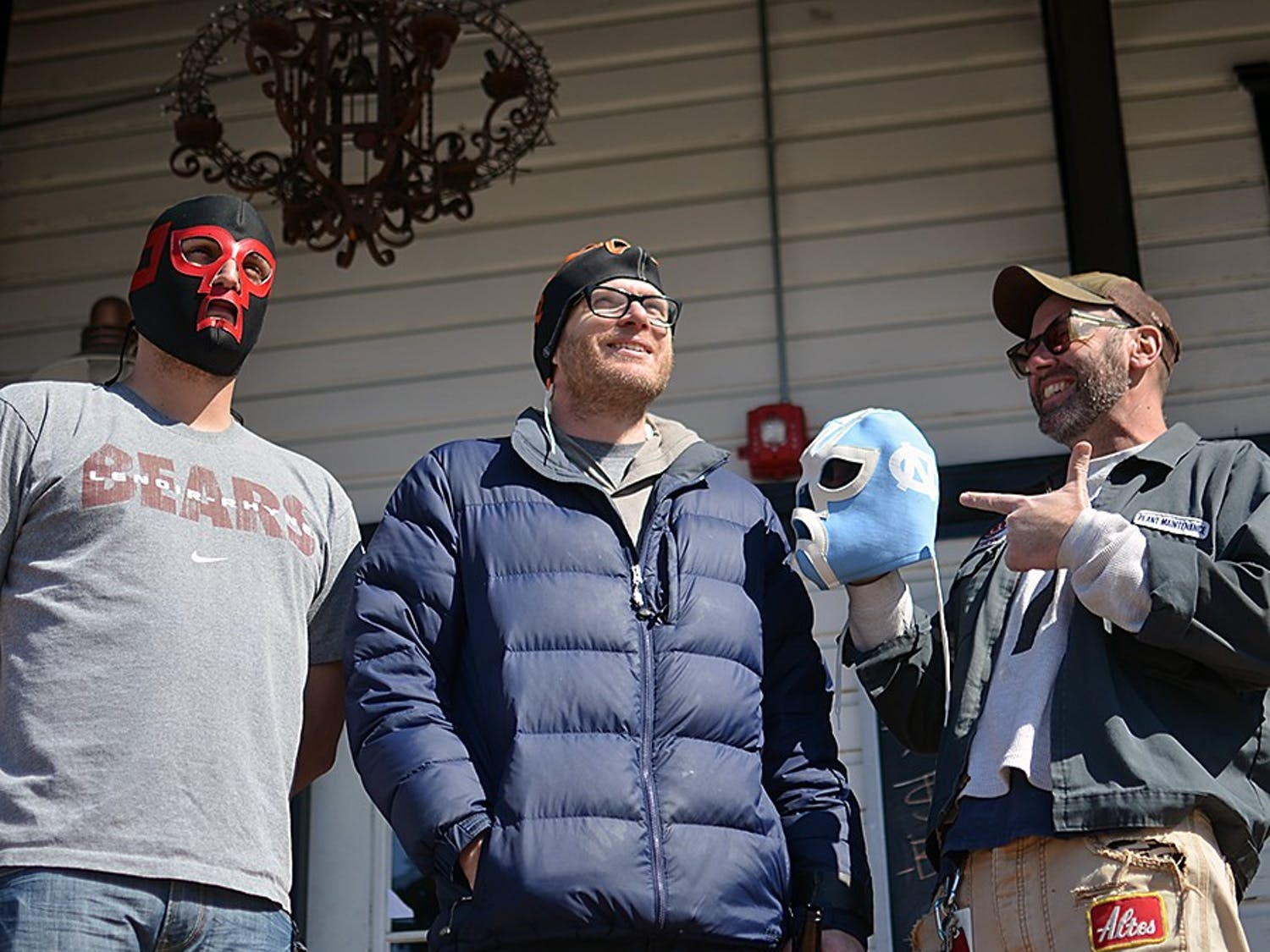 Alex Freeman (left), Chip Hoppin (middle), Mike Benson (right), and Mike Tyrrell (not pictured), own a mask making business in Carrboro. They have been making masks for ten years.