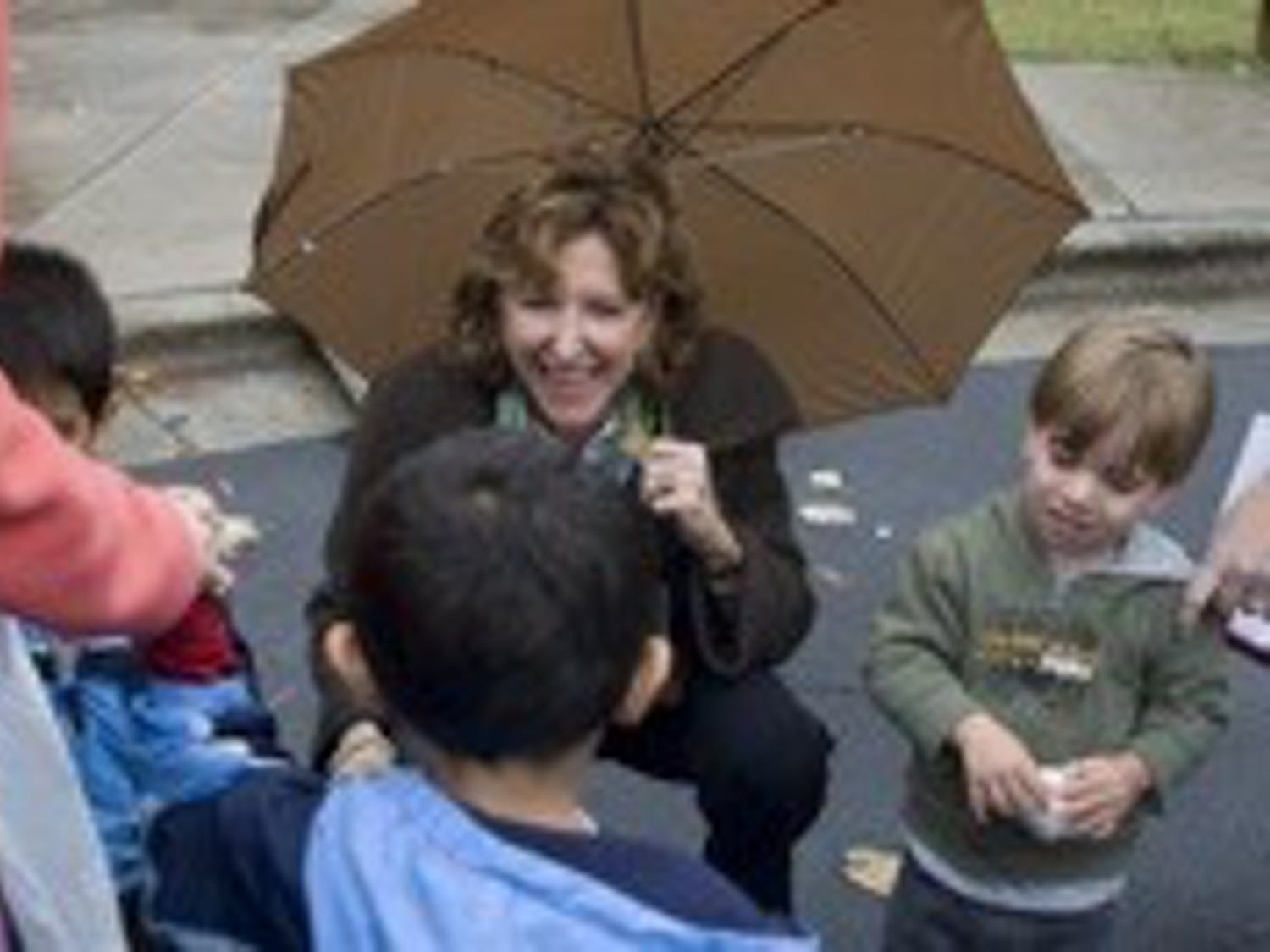 Outside the polls: Democrat N.C. Sen. Kay Hagan of Guilford County greets a family at the St. James United Methodist Church polling place in Raleigh as she travels around the state to talk to voters on Election Day. The U.S. Senator-elect later celebrated her victory over incumbent Republican Elizabeth Dole at a rally in Greensboro Coliseum.