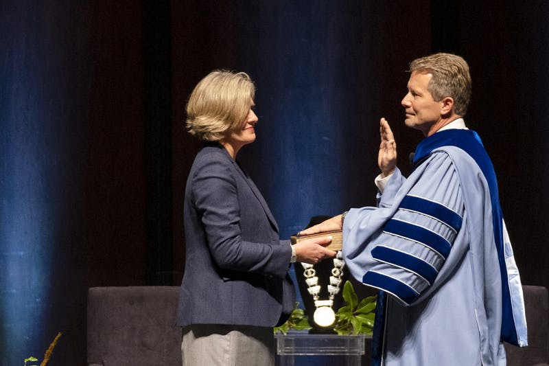 Amy Guskiewicz participates as Kevin M. Guskiewicz is installed as the 12th Chancellor of the University of North Carolina at Chapel Hill during a ceremony held at Memorial Hall on October 11, 2020. Photo courtesy of Jon Gardiner/UNC-Chapel Hill.