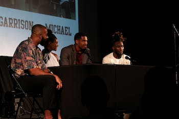 Michael Carter discusses his personal experience with what it means to be Black at UNC with fellow student athletes (from left) Jake Lawler, Brianna Pinto and Garrison Brooks on Sept. 18, 2019 at the premiere of UNCUT at Varsity Theatre.