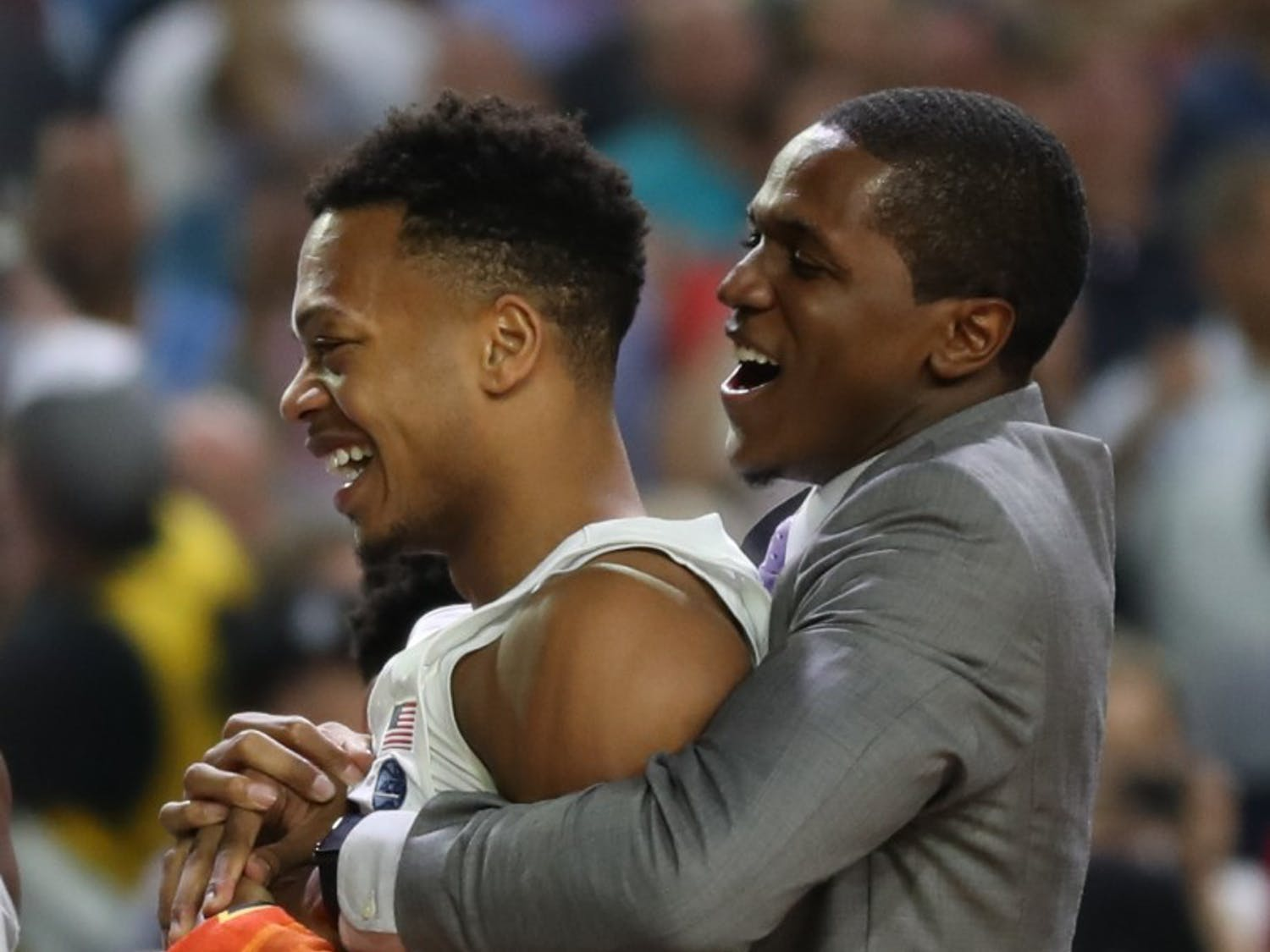 North Carolina guard Kenny Williams lifts up guard Nate Britt (0) on the bench in the final seconds of the NCAA Men's Basketball Championship against Gonzaga Monday night in Phoenix.
