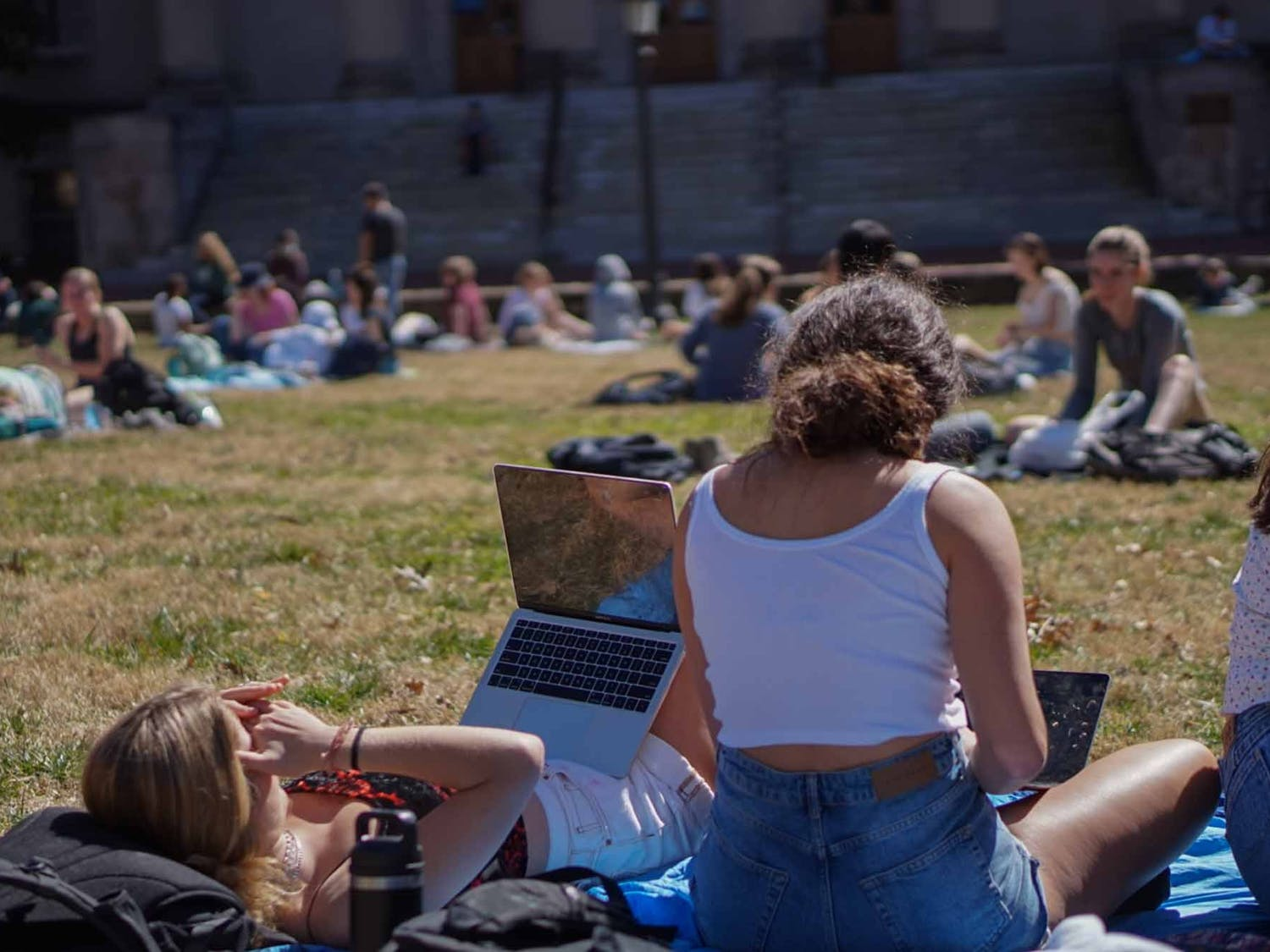 Students embrace the spring weather on the quad on Wednesday, Feb. 24, 2021.