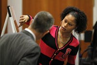 With the assistance of Orange DA James Woodall, Jr, left, prosecution witness Shanita Love, right, the former girlfriend of DeMario Atwater on Friday, Dec. 9, 2011 indicates to the Lovette jury where on an aerial photograph of Durham, NC she witnessed defendant Laurence Alvin Lovette, 21, dispose of three pieces of a semi-auto pistol back in March, 2008. Love was the first witness at the start of the third day of testimony in the Lovette trial for kidnapping, robbery and murder of UNC student body president Eve Carson on March 5, 2008.