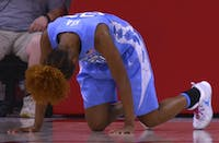 North Carolina guard Paris Kea (22) struggles to get up after taking a hard fall after a missed layup attempt against N.C. State Thursday night.