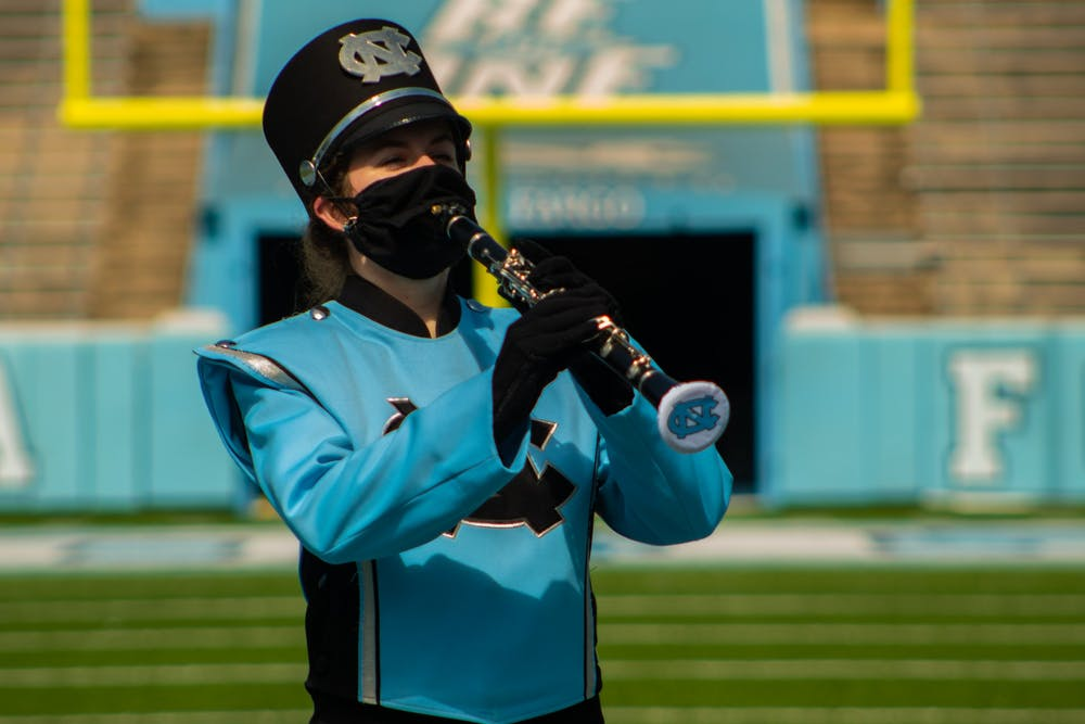 Sophomore Madi Marks plays a scale on her clarinet while demonstrating the new safety precautions the Marching Band must take to protect against COVID.