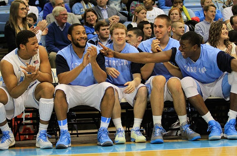 UNC players joke on the bench after beating the Fighting Irish 63-61 Monday.