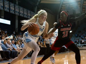 Senior guard Taylor Koenen Bennett (1) dribbles past an opposing player in the game against Louisville at Carmichael Arena on Sunday, Jan. 19, 2020. UNC lost 67-74.