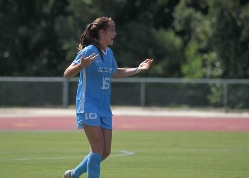 Senior defender Julia Ashley throws her hands in the hair during UNC's 3-2 exhibition win over N.C. State on Aug. 9 in Raleigh.