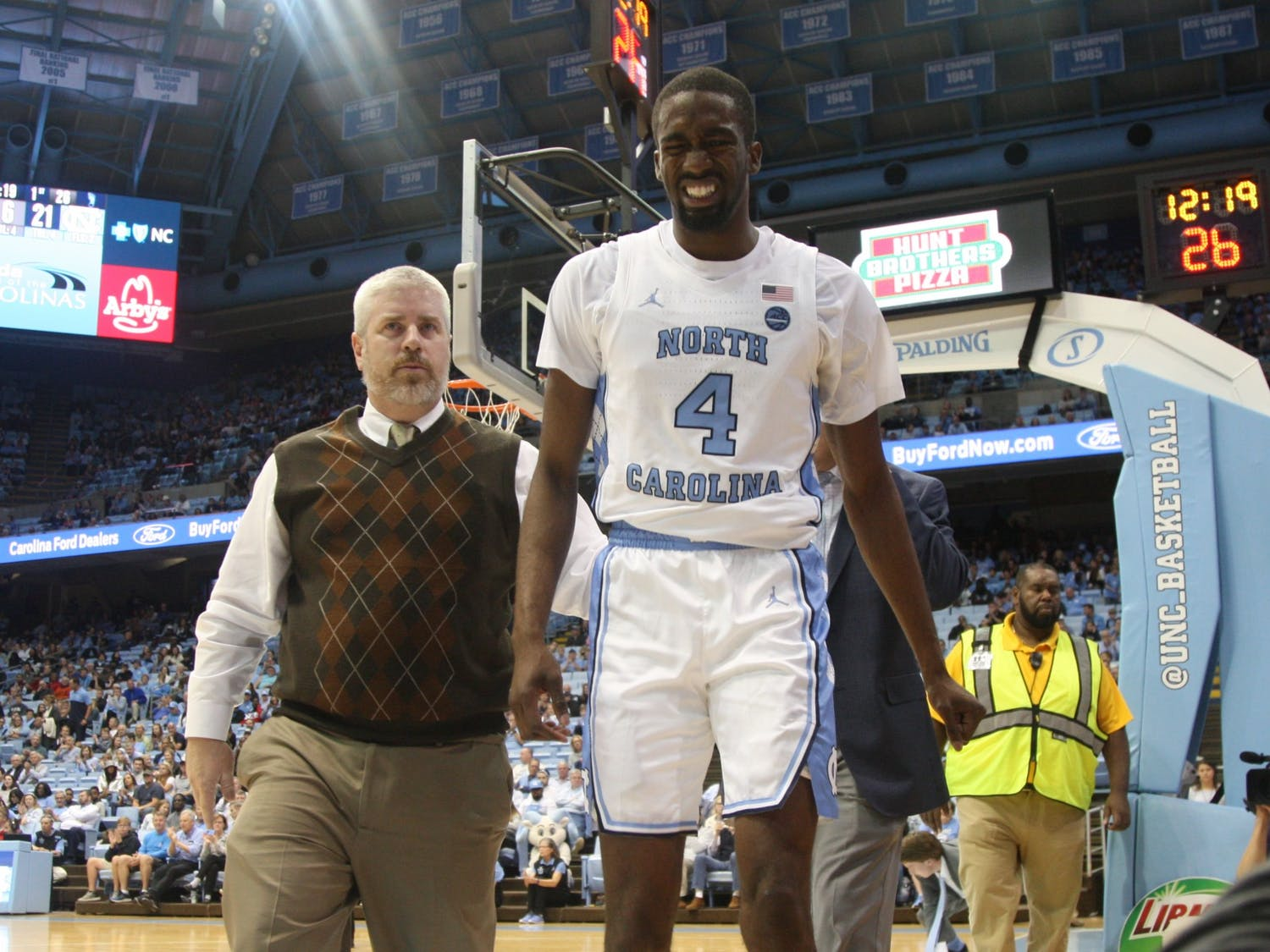 Senior guard Brandon Robinson (4) walks off the court after an injury during the exhibition game on Friday, Nov. 1, 2019. UNC beat WSSU 96-61.