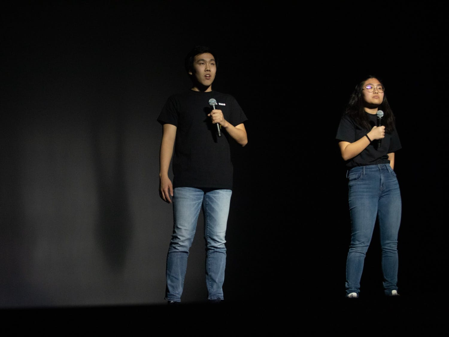 Andy Liu (left) and Emily Kang (right) perform spoken word poetry at Journey Into Asia at Memorial Hall on Saturday, Feb. 29, 2020. Liu and Kang delivered a poem originally written by Ins Choi in response to Asian American actors departing from the show Hawaii Five-O because of a wage gap between them and their white counterparts.