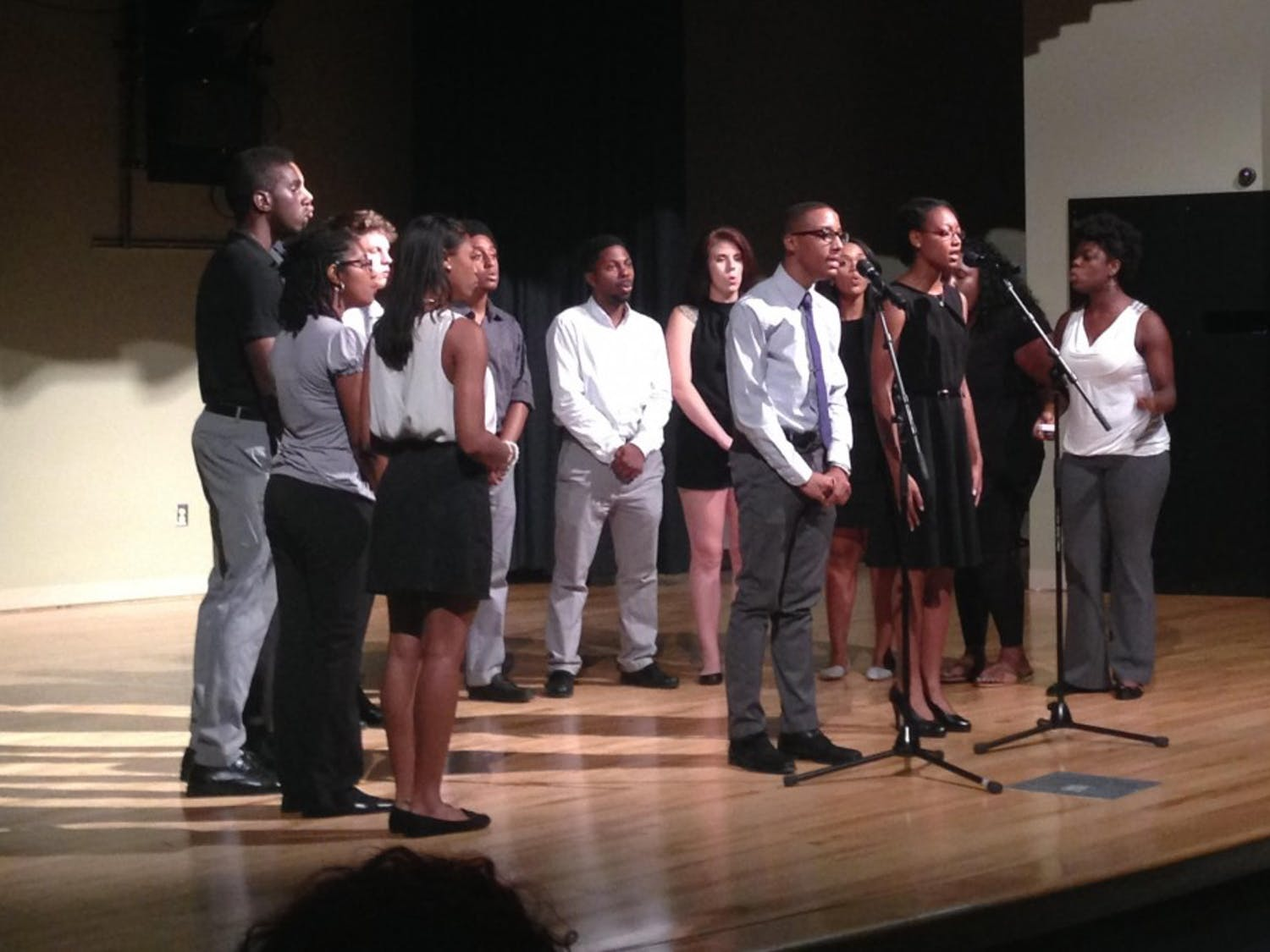 The Harmonyx, a sub group of the Black Student Movement, performs as a part of a BSM meeting.