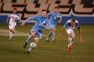 Junior forward Billy Schuler chases down the ball in Friday's national semifinal.