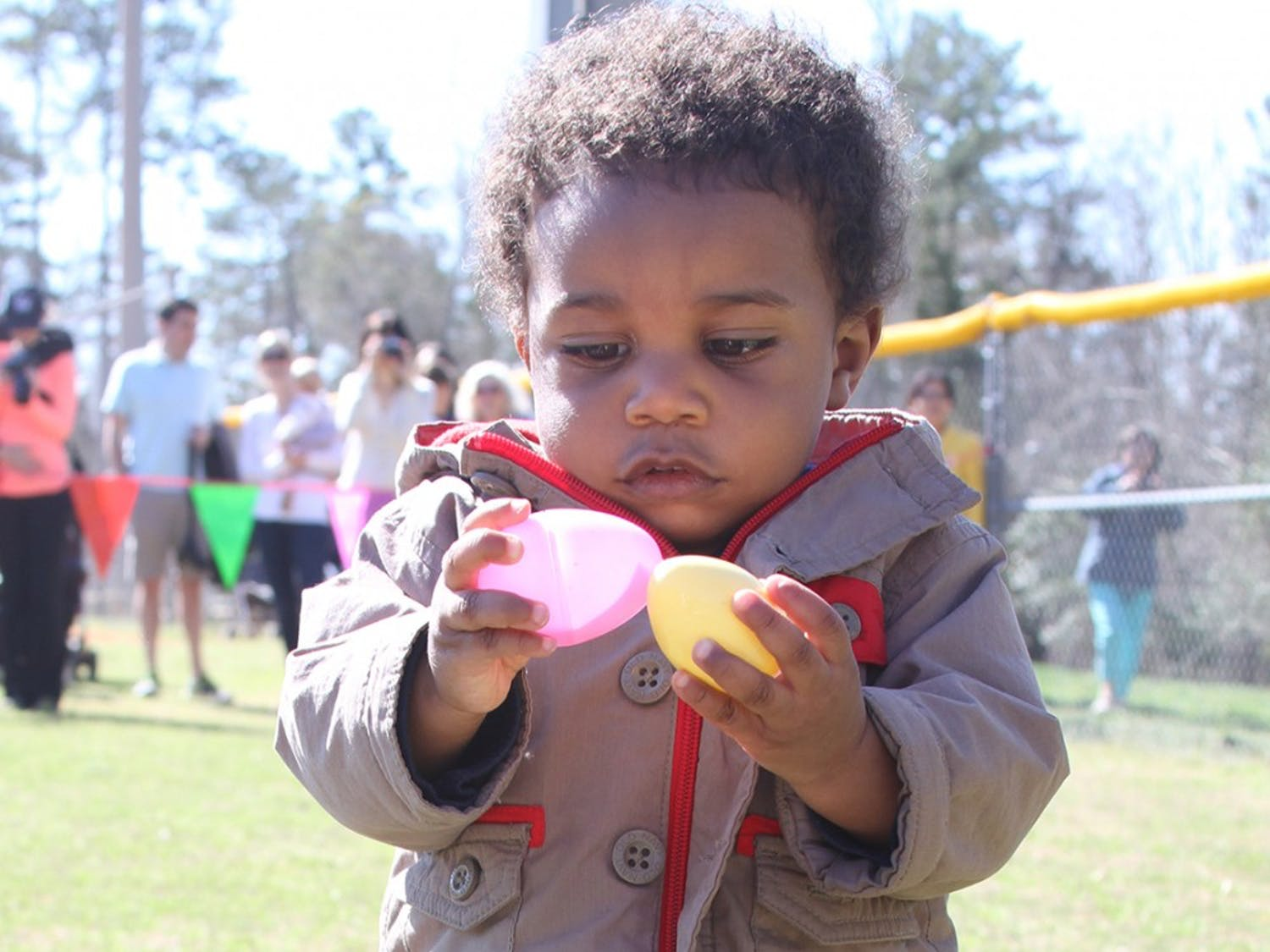 Kids participate in an egg hunt at Homestead Park in Chapel Hill on April 5.