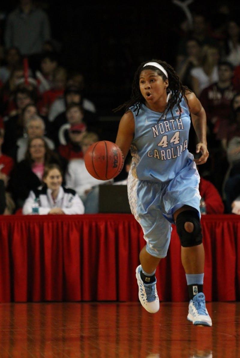 Tierra Ruffin-Pratt brings the ball up the court.