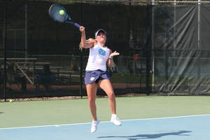 Makenna Jones hits a return against Virginia on April 13 at the Cone-Kenfield Tennis Center.