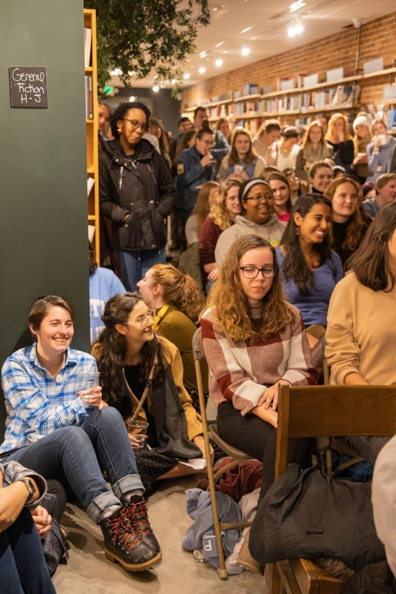 Audience members watch comedians perform at the bitter/sweet comedy show at Epilogue Books Chocolate Brews on Thursday, Nov. 14, 2019.