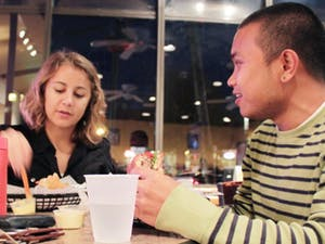 """First year marine science grad students Sara Coleman and John Paul Balmonte took a break from school work to eat at Buns to support """"Dine Out"""" Restaurants participating in the program donate 10% of their profits to IFC shelters. They saw the event advertised in the newspaper and decided to come out. John Paul Balmonte said they chose Buns because """"it's delicious and I love the curry mustard!"""""""