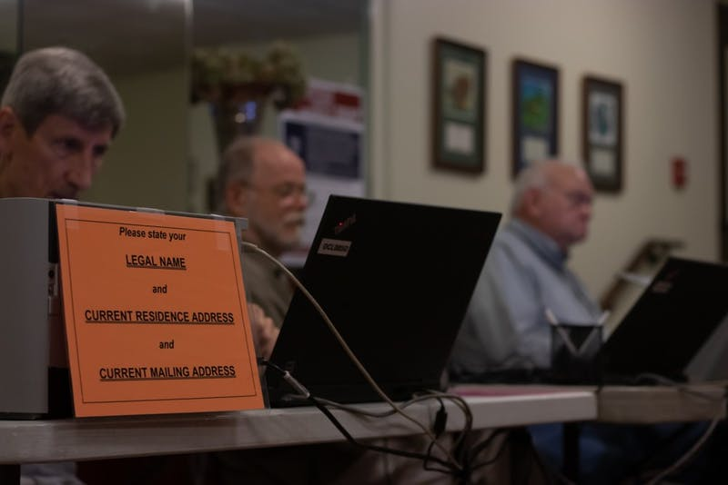 Orange County Election officials, Ed Tostanoski, Dirk Kelder, and Joe Jackson wait to help early voters cast their vote at Chapel of the Cross church at 304 Franklin St. on Wednesday, Oct. 30, 2019.