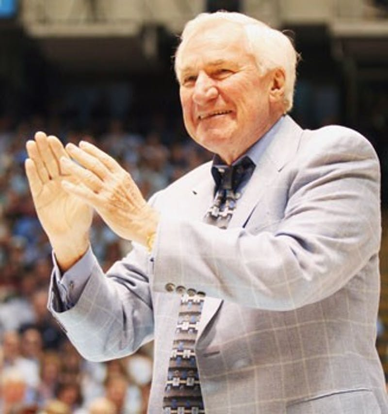 "Former UNC coach Dean Smith was honored as a member of the basketball Hall of Fame at halftime of Saturday?s game against Virginia"" along with UNC greats Billy Cunningham Robert McAdoo and James Worthy."