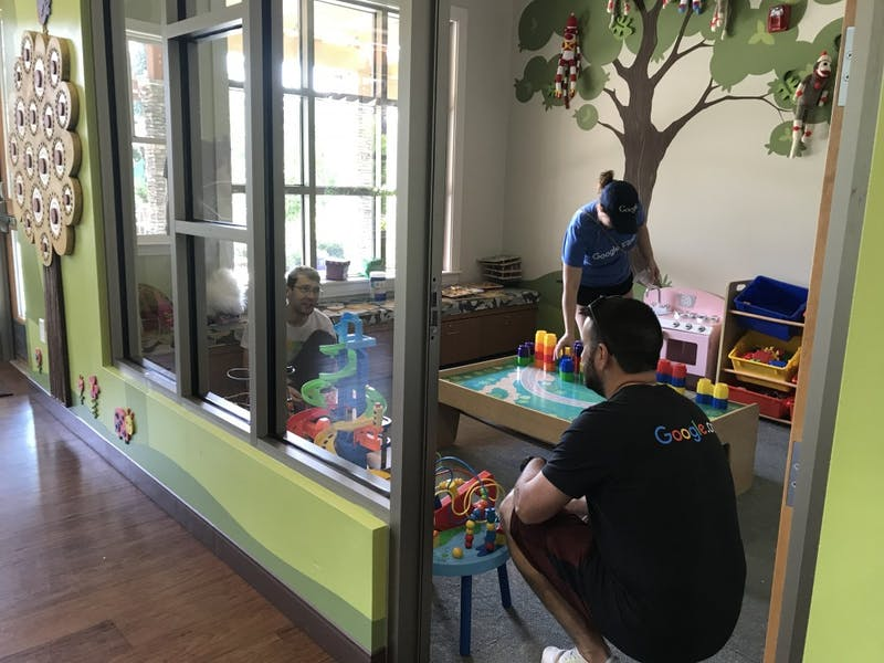 Local Google employees clean toys at the Ronald McDonald House of Chapel Hill as part of GoogleServe, a month-long volunteer program.