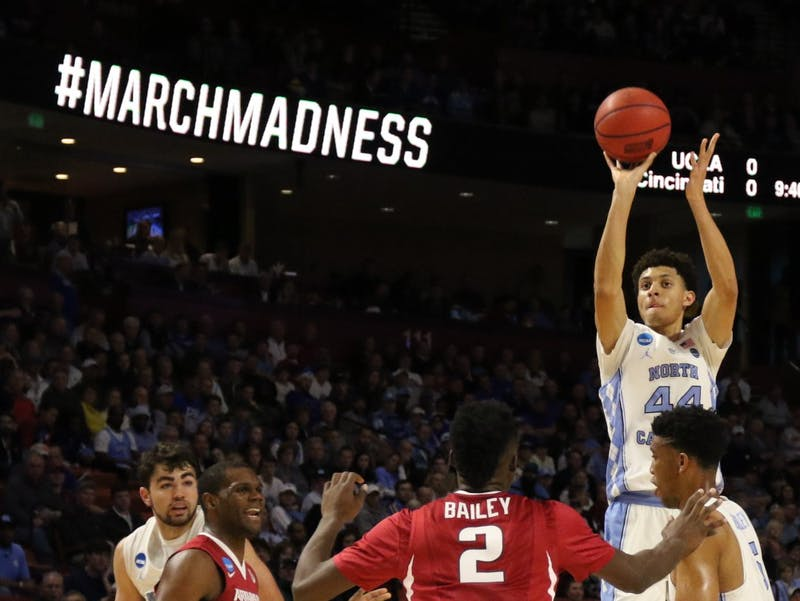 The North Carolina men's basketball team escaped a near upset by Arkansas, edging the Razorbacks 72-65 in the second round of the NCAA Tournament in Greenville on Sunday. The Tar Heels will play Butler on Friday in the Sweet 16 in Memphis.