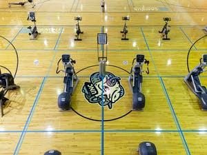 Cardio machines lie on the basketball courts in Ram's Head gym on UNC's campus on Feb. 6, 2021.