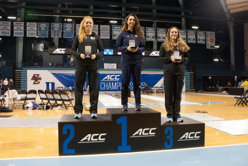 UNC's Georgina Summers (left) poses with her silver medal from the individual women's epee competition on Feb. 24 in Carmichael Arena.